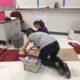 Students building the wardrobe prop