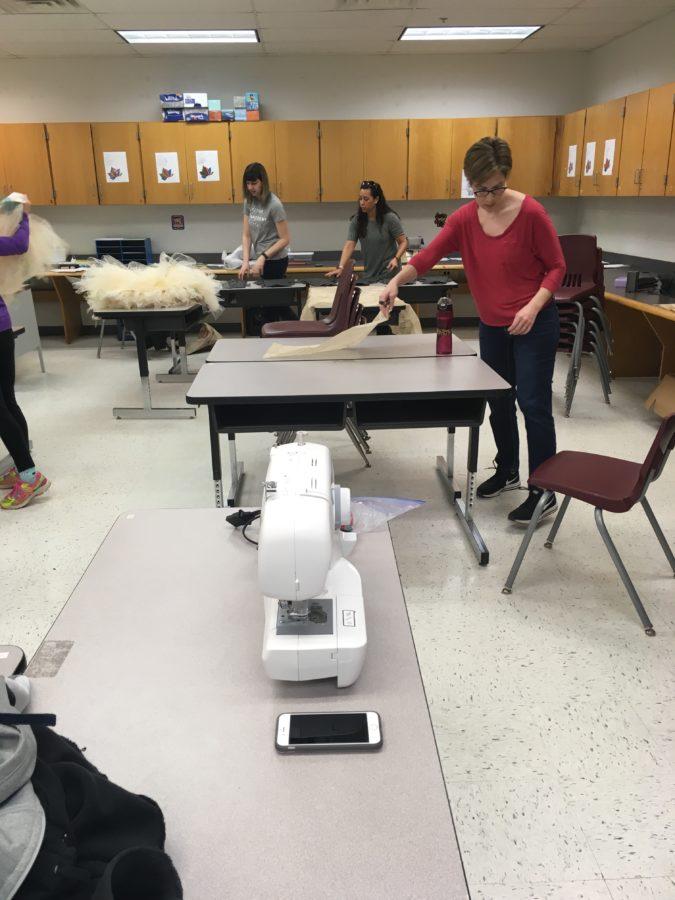 Volunteers working on costumes