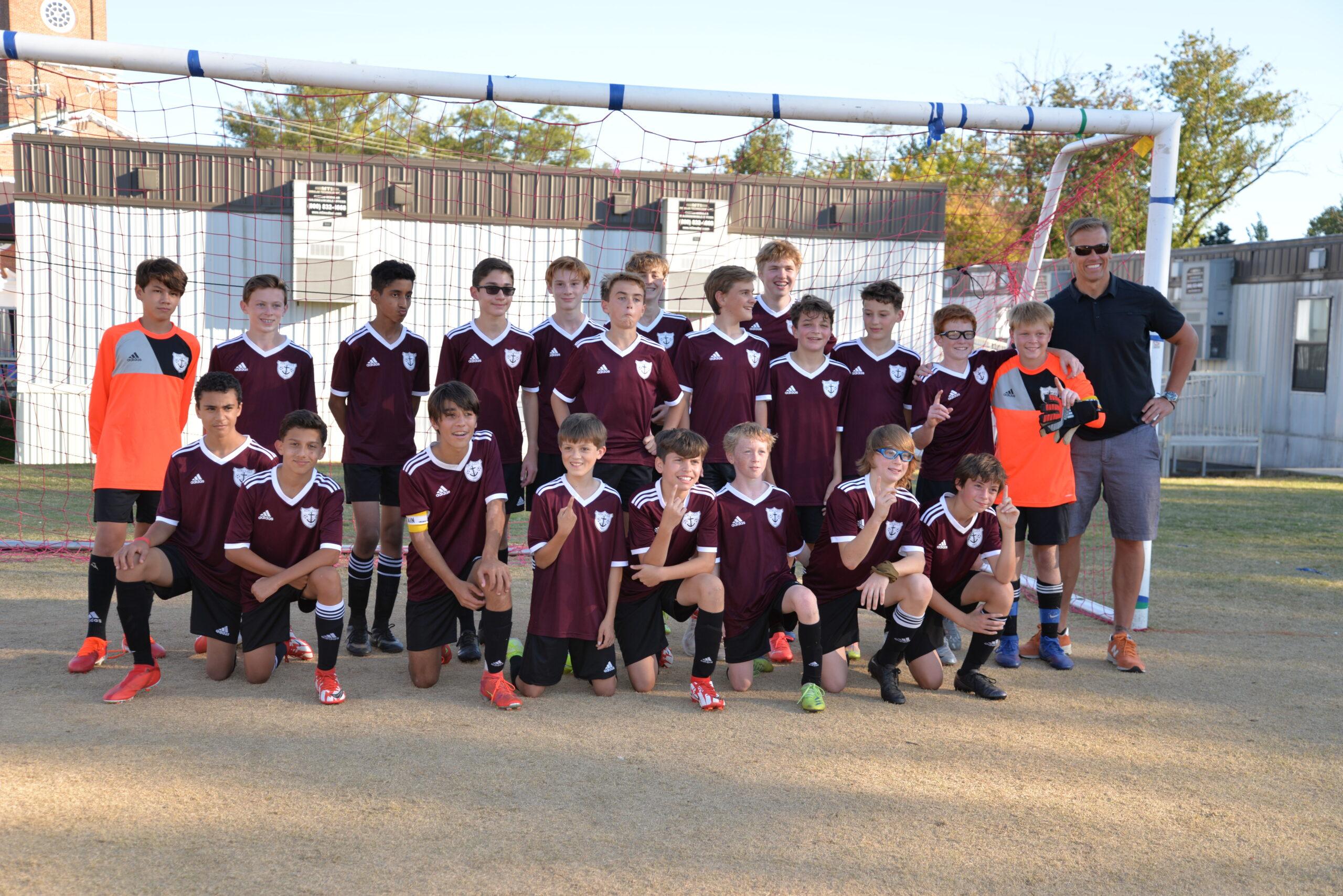 Campeões do condado de futebol dos meninos!